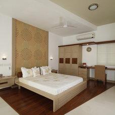 Modern Bedroom by Building Designs