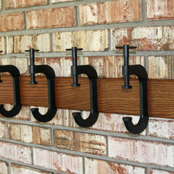 C Clamp Coat Rack by G.B. Trains - This reminds me so much of the industrial coffee table carts available at Restoration Hardware. Seeing the clamp repurposed is unexpected, and I love the unexpected.