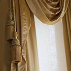 Victorian style window treatments in bronze satin fabric with tassels and swags - A San Francisco Victorian home gets period drapery in a rich satin jewel tone with dramatic swags and custom tassels. A contemporary interpretation of Victorian style period materials by Stitch Custom Furnishings.