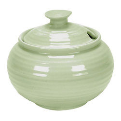 Portmeirion - Sophie Conran Sage Covered Sugar Jar Multicolor - 456136 - Shop for Condiment Supplies from Hayneedle.com! You'll be sweet on the simple design of the Sophie Conran Sage Covered Sugar Jar. This stylish durable jar will your beloved sugar close by while blending beautifully with the rest of your coffee or tea service. Plus you'll love the easy cleanup it's microwave- and dishwasher-safe.About PortmeirionStrikingly beautiful eminently practical refreshingly affordable. These are the enduring values bequeathed to Portmeirion by its legendary co-founder and designer Susan Williams-Ellis. Her father architect Sir Clough Williams-Ellis was the designer of Portmeirion the North Wales village whose fanciful architecture has drawn tourists and artists from around the world (including the creators of the classic 1960s TV show The Prisoner). Inspired by her fine arts training and creation of ceramic gifts for the village's gift shop Susan Williams-Ellis (along with her husband Euan Cooper-Willis) founded Portmeirion Pottery in 1960. After 50+ years of innovation the Portmeirion Group is not only an icon of British design but also a testament to the extraordinarily creative life of Susan Williams-Ellis.The style of Portmeirion dinnerware and serveware is marked by a passion for both pottery manufacturing and trend-setting design. Beautiful tactile nature-inspired patterns are a defining quality of Portmeirion housewares from its world-renowned botanical designs modeled on antiquarian books to the breezy natural colors of its porcelain and earthenware. Today the Portmeirion Group's design legacy continues to evolve through iconic brands such as Spode the Pomona Classics collection and the award-winning collaboration of Sophie Conran for Portmeirion. Sophie Conran for Portmeirion:Successful collaborations have provided design inspiration throughout Sophie Conran's life. Her father designer Sir Terence Conran and mother food writer Caroline Conran have been the pilla