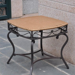 International Caravan - Patio Side Table in Honey Pecan Finish - Water resistant. UV light fading protective coating. Durable powder coated steel frame. Made from wicker resin. Assembly required. 22 in. W x 22 in. D x 21 in. H (16 lbs.)The Valencia wicker resin outdoor side table is a perfect accent piece for any outdoor setting.