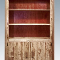 Montana Woodworks - Bookcase in Stained and Lacquered Finish - Handcrafted. Rustic furniture and environmentally friendly. Solid lodge pole pine accents. Durable build and fit. Trim pieces are sawn square. Heirloom quality. Edge glued panels. Made from solid grown wood and timbers. Made in USA. No assembly required. Shelve: 14 in. D. Panel door: 20 in. W x 30 in. H. Overall: 44 in. W x 17 in. D x 63 in. H (100 lbs.). Warranty. Use and Care InstructionsMontana woodworks, the largest manufacturer comes the all new homestead collection line of furniture products. This is sure to stand out in any room. Shelves have plenty of room for books, collectables and family heirlooms. Each piece signed by the artisan who makes It.