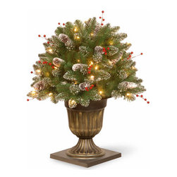 Glittery Spruce Christmas Bush With Clear Lights - Measures 26 inches tall with 22 inch diameter. Indoor or covered outdoor use. Trimmed with red berries, pine cones and glitter. Pre-lit with 50 UL listed, pre-strung Clear lights. Decorative urn base. Tip count: 142. Light string features BULB-LOCK to keep bulbs from falling out. Fire-resistant and non-allergenic. Packed in reusable storage carton.