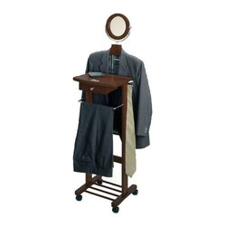 "Winsome Trading Inc - Valet Stand Deluxe Edition - This dresser valet stand can accommodates a shirt jacket trousers and pair of shoes. The dresser valet stand is the perfect gift for him. This valet features a center storage drawer perfect for keys and a wallet and a tilt mirror for a quick morning brush up. The base holds a pair of shoes and is on rolling casters making it very easy to move around. Finsih: Antique WalnutOverall Dimensions: 56.34""H x 15.45""W x 19.84""DWeight: 19 lbs."