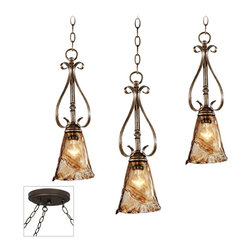 """Franklin Iron Works - Traditional Amber Scroll Bronze Triple Multi Light Pendant - Our multi swag chandeliers let you add designer lighting to any room. The special swag canopy installs into any ceiling junction box just like a normal ceiling light or chandelier. Install hooks in the ceiling and swag the chain to the canopy; adjust the hanging length as desired. With the hanging options you can get the exact look and light placement you need. This version features a bronze finish triple swag canopy. It's paired with three designer bronze finish mini pendant lights with amber art glass and highlights of gold and silver in the finish. From Franklin Iron Works. Multi swag chandelier. With three designer amber mini pendants. Includes bronze finish special canopy adaptor. Installs into any ceiling junction box. Includes swag hooks and mounting hardware. Each pendant includes 6 feet chain 12 feet lead wire. Takes three 60 watt bulbs (not included). Canopy is 7"""" wide.  Multi swag chandelier.  With three designer amber mini pendants.  Includes bronze finish special canopy adaptor.  Installs into any ceiling junction box.  Includes swag hooks and mounting hardware.  Each pendant includes 6 feet chain 12 feet lead wire.  Takes three 60 watt bulbs (not included).  Canopy is 7"""" wide.  Each pendant is 19 1/2"""" high 6"""" wide.  Some assembly required; instructions included."""