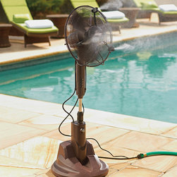 """Frontgate - Portable Dry Misting Outdoor Fan - Reduces outdoor temperature up to 30˚F. 3 patented nozzles create a mist so fine, it's literally dry. No wet spray that dampens skin, hair, clothes, furniture or food. No slippery floors. Safeguards those with low heat tolerances. The Portable Dry Misting Fan reduces the temperature by 30˚F and it does it without dampening your food, clothes, hair, or furniture. The fan's patented misting technology breaks the water molecules down to microscopic levels—once the mist travels beyond 6 inches, it feels cool and dry with no detectable drips, drops, or water condensation. You can adjust the mist output to suit your comfort zone, or use the fan-only option to stay cool on a terrace, in the garage, or as you relax by the pool.  . 3 patented nozzles create a mist so fine, it's literally dry .  . . . Eco-friendly and energy efficient. Uses one-sixth the amount of water required by other misting fans and operates on less electricity than three 60-watt light bulbs. 3-speed fan head oscillates 90˚ . Mist volume control . Attaches to a standard hose . Telescopes 44""""-52""""H . Motor RPM range is L-975/M-1100/H-1225 . Uses 1/2 gallon of water per hour. 6 ft. cord; 120V . Fan decibal rating: Low: 44, Medium: 49, High: 54. View Owner's Manual and Technical Specifications (PDF format)."""