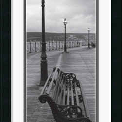 Amanti Art - Bench on the Boardwalk Framed Print - The timeless sophistication of black & white photography is a simple and easy way to add style and character to your space. A welcoming park bench on a quiet boardwalk invites meditative thought and an escape from the turbulence of everyday life.