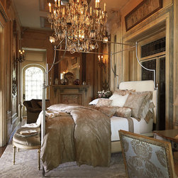 "Frontgate - Park Lane Canopy Bed - Frontgate - Can accommodate sheers or mosquito netting. Pairs with any decor from traditional to contemporary. Finials mimic the look of fine English sterling silver tea sets of the Regency period. Legs are fitted in sand-cast Marlborough feet. Height from floor to bottom of bed: 12"".. The Park Lane Canopy Bed's clean, curvilinear profile and regal finials project English Regency styling, while its contemporary steel frame boasts a timeless silver-leaf finish. Arching in the headboard, footboard and stretchers offset the canopy's curves. Ivory velvet upholstery adorns the headboard and footboard, accentuating the soothingly cool palette.  .  .  .  . . Assembly required . Imported."