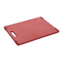 Jelli® Red Nonslip Reversible Cutting Board - Every modern breakthrough in efficient prep is represented in these colorful boards of high-density polypropylene designed by U.S. designer Ellis Shamoon. Reversible design doubles the convenience, while nonslip feet grip surfaces to keep food in control. Solid one-piece design with cutout handle ensures stability of gripper feet. All-purpose boards protect counters and tables from scratches.