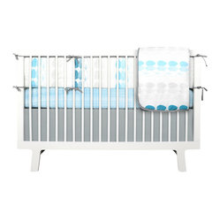 Olli and Lime - Blue and Gray Trees 4-piece Baby Bedding Set - This color palette is so calming. It looks like a perfect place for a baby to dream. The gray accents make the shades of blue feel modern, and just imagine a beautiful nursery designed around the bedding.