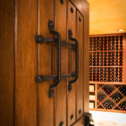 Custom Wine Cellar Doors - Custom wine cellar doors designed by Joseph & Curtis Custom Wine Cellars. We sell and design wine cellars - including doors, racks and all of the cooling equipment and accessories needed for a fine wine cellar.