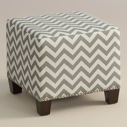 "World Market - Ash Zigzag McKenzie Ottoman - Cozy up with our custom-made Ash Zigzag McKenzie Ottoman, handcrafted in the U.S.A. with cotton upholstery and nail head trim. Showcasing a fresh gray and white chevron print, this plush ottoman makes a bold statement. Pair two ottomans for a dramatic ""bench"" at the foot of the bed. Shop our coordinating bed or headboard in the same custom fabric for a pulled together look."
