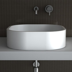 MaestroBath - Square Contemporary Vessel Sink | White Polymer Flat Luxury Italian Design - Designed elegantly in the shape of a square with generously round edges this sink is unique in every way. Unlike many other counter top wash basins, Kappa seems to be extruding out of its surrounding due to its straight walls and no space underneath which make it sit flush on the counter top. Made out of TeknoForm, a durable polymer-based material, Kappa is available in a clean white color and it may very well be the perfect sink for your contemporary space.  Here is more information related to MaestroBath: Services Provided: Luxury Handmade Italian Vessel Sinks, Modern and Contemporary Kitchen and Bath Fixtures .. Areas Served: All United States and International Countries… Business Description: Maestrobath delivers contemporary and modern handmade Italian bathroom sinks and designer faucets to clients with taste of luxury. It carries a wide selection of beautiful and unique Travertine, Crystal and Glass vessel sinks in variety of colors and styles. Maestrobath services homeowners and designers Globally. Furthermore, it has dealer partners across United States and international countries.