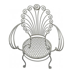 "Iron Shell Chair - Vintage white wrought iron garden chair. Elegantly weathered, its scallop shell shaped back sets it apart from the crowd. Seat height 17"", back height 35"", 17""d"