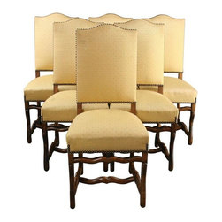 Vintage Dining Chairs French 1950 Oak Wood - S/6 - Impress your friends with this nice set of 6 vintage French chairs, designed for the dining room but they'd also serve you proud as side chairs or occasional seating. The solid oak chairs date to 1950 France, featuring beautifully crafted Sheepbone legs and stretchers. The pale yellow upholstery on the seat and back is designed with a grey box pattern, with quite a few stains and dirty spots on these authentically old chairs. The fabric may or may not clean up. Take the opportunity to customize the chair upholstery to match your interior decor! The armless dining chairs measure 42.25 inches high, and 18.75 inches wide by 18 inches deep, and the seat height is 20.50 inches. Overall Condition is Used - Good. Shows normal wear to the finish and miscellaneous nicks, dings, and scratches. The pale yellow upholstery with a grey box pattern has quite a few stains and dirty spots that may or may not come clean.