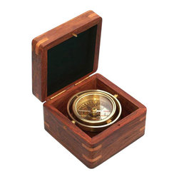 Miniature Gimbaled Boxed Compass - The Miniature Boxed Compass is a beautiful reproduction of a small antique brass gimbaled compass in a brass-inlaid solid hardwood box.  The 2-inch (5.1 cm) diameter compass is fully gimbaled with a solid brass gimbal set.  The hardwood case is 3 1/2 inches (8.9 cm) square and 2 1/2 inches (6.4 cm) tall, and the compass weighs 10 ounces (284 grams).  The corners of the box are reinforced with lighter hardwood splines.  This handsome compass makes a beautiful addition to a nautical collection or executive's desk.