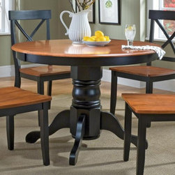 Home Styles - Home Styles Black & Cottage Oak Dining Table - 5168-30 - Shop for Dining Tables from Hayneedle.com! Traditional design and modern style collide with the elegant Home Styles Black & Cottage Oak Dining Table. This beautiful pedestal table features soft curves and a sleek look that adds a bold new level of sophistication to any room. The black base and cottage oak tabletop finish complement one another beautifully for a traditional dining setup that can seat up to four adults comfortably. This progressive table measures 42L x 42W x 30H inches and there are matching chairs available. About Home StylesHome Styles is a manufacturer and distributor of RTA (ready to assemble) furniture perfectly suited to today's lifestyles. Blending attractive design with modern functionality their furniture collections span many styles from timeless traditional to cutting-edge contemporary. The great difference between Home Styles and many other RTA furniture manufacturers is that Home Styles pieces feature hardwood construction and quality hardware that stand up to years of use. When shopping for convenient durable items for the home look to Home Styles. You'll appreciate the value.