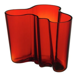 "iittala - Alvar Aalto Large Flaming Red Vase - A shape constantly interpreted, the Alvar Aalto collection of vases stays true to the original design concept. More than 70 years after the original debut, the design continues to provoke attention by letting the owner decide its use and complementing our busy lives with a touch of nature. Filled with fresh cut flowers or arranged with other collection pieces as works of art, this eternal classic is essential to the modern home. The Aalto glass pieces have a multi-stage production. The non-leaded crystal is first mouth blown before going into a wooden mold to create the classic Aalto shape. The pieces are then hand cut and go through several polishing and finishing steps before they are completed, creating a piece worthy of permanent display at the Museum of Modern Art. In addition to the standard Aalto colors, each year iittala selects two new glass colors to run in limited production. Features: -Mouth blown non-leaded crystal -Features designer's signature on the bottom -Not dishwasher safe, hand wash only -Overall dimensions: 6.25"" H -Please Note: Due to the nature of hand-blown glass, actual color may vary slightly from the colors pictured"