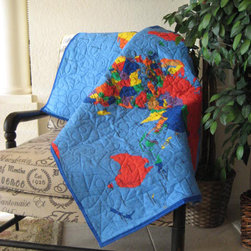 World Map Quilt by Great Quiltations - This map quilt would be perfect as a wall hanging or something to snuggle under during story time.