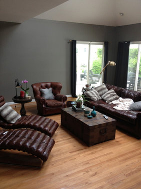 masculine living room accents art area rug furniture placement advice