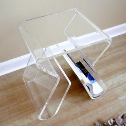 Baxton Studio Transparent Magazine Rack End Table - Sometimes, decorating a room can feel a little like matching all the right puzzle pieces together to create the prettiest, most complete picture. And undoubtedly, one of the coolest pieces in the puzzle of your home will be the Baxton Studios Transparent Magazine Rack End Table, a clear, contemporary side table and magazine rack with an utterly modern shape.The table is constructed with a durable clear acrylic material, artistically bent to form its dual function. The curved legs are open, integrating storage bins for magazines and other print material on the inside of the legs. The small top is perfect for little reading lamps and a cup of tea, and the overall small scale and clear color won't detract from a room's other bolder components. It will, however, catch an eye or two - it's impossible not to notice.About Baxton StudiosThis item is designed and manufactured by Baxton Studios, a furniture company based near Chicago. A lot goes into the making of Baxton Studios furniture, and it all starts with attention to details. They hand select their unique line of leather and micro-fiber fabrics. Their furniture is padded with high polyurethane foam to create the body contouring comfort and support for which Baxton Studios is famous. All frames are constructed of high quality wood or steel on select models, providing sturdy frame construction that exceeds industry standards. Baxton Studios is committed to constantly providing stylish and unique furniture for the best value to help you create a comfortable living space with ease and confidence.