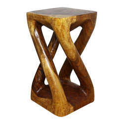 Kammika - Vine Twist Stool Sustainable Wood 12 x 12 x 22 inch Ht w Eco Friendly Walnut Oil - Our Sustainable Monkey Pod Wood Vine Twist Stool 12 inch x 12 inch x 22 inch height with Eco Friendly, Natural Food-safe Livos Walnut Oil Finish transports you to Thailand where the Monkey Pod tree grows rapidly. Its graceful legs stretch and curve from base to top - in the manner of tree vines. Try them out as an end table, or display stand for lamps or decor. They are sturdy, and yet light so that you can move them easily for maximum effect in the decorating scheme of your choice. Made from the branches of the Acacia tree in Thailand - where each branch is cut and carved to order (allowing the tree to continue growing), the wood is dried, carved and sanded by Thai artisans, creating a beautiful, sturdy and sustainable place to sit. They are then rubbed in Livos Walnut tone oil creating a water resistant and food safe matte finish. These natural oils are translucent, so the wood grain detail is highlighted. Color ranges from medium to dark Walnut brown tones that will darken as the wood ages. There is no oily feel and cannot bleed into carpets, as it contains natural lacs. All products are dried in solar or propane kilns. No chemicals are used in the process, ever. Each piece is a Work of Art! We make minimal use of electric hand sanders in the finishing process. After each Monkey Pod wood (Acacia, Koa, Rain Tree grown for wood carving) piece is dried, carved and sanded by local Thai artisans, it is rubbed with Livos all natural oil, and then packaged with cartons from recycled cardboard with no plastic or other fillers. As this is a natural product, the color and grain of your piece of Nature will be unique, and may include small checks or cracks that occur when the wood is dried. Sizes are approximate. Products could have visible marks from tools used, patches from small repairs, knot holes, natural inclusions or holes. There may be various separations or cracks on your piece when it arrives. There may be some slight variation in size, color, texture, and finish.Only listed product included.