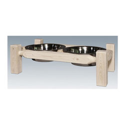 "Montana Woodworks - Wooden Pet Feeder - Includes two embossed stainless steel bowls. Hand crafted. Sawn square timbers and trim pieces for rustic timber frame design. Heirloom quality. Solid lodge pole pine. Mortise and tenon joinery system. Made from U.S. solid grown wood. Lacquered finish. Made in U.S.A.. No assembly required. 23 in. W x 13 in. D x 7 in. H (8 lbs.). Warranty. Use and Care InstructionsFrom Montana Woodworks, the largest manufacturer of handcrafted quality log furnishings in America comes the all new Homestead Collection line of furniture products. Add rustic decor to your pets dinnertime! This delightful pet feeder is the perfect gift for a man or woman's best friend. This unique pet feeder is sure to elicit ""oohs"" and ""aahs"" from family, friends and best friends. Don't have a pet? Use this ""feeder"" to satisfy the cravings of your other friends at parties and events. Chips in one side, dip in the other. Each piece signed by the artisan who makes it."