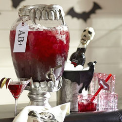 Vampire Teeth Drink Dispenser Stand - I adore this vampire teeth beverage dispenser stand. It would be quite the conversation piece with Halloween guests.