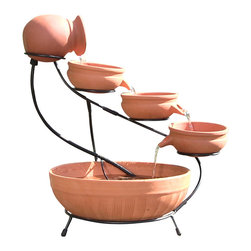 Sunnydaze Decor - Terracotta Cascade Solar Fountain - This solar fountain brings life to your outdoor living spaces.  The hand crafted Terracotta solar fountain can be used anywhere outdoors without any electricity as it uses the natural sunlight to pump the water through the cascading bowls.  The 6 volt solar pump in the bottom basin continuously circulates the water up to the top pitcher, where the water cascades down the levels into the pool of water in the basin, making soothing water sounds.  It looks spectacular accented with plants and greenery around it so it is perfect as a center point in your gardens.