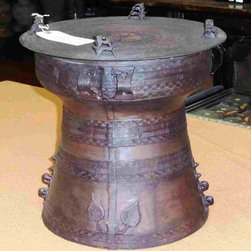 Bronze Rain Drum 4 - This is a rain drum from Thailand made out of bronze. It makes a terrific side table next to or in between a pair of chairs. Or use it as a small bedside table when there is very little room for a conventional table. It is a great way to mix a bit of Asia into your home.