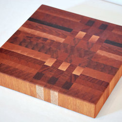 Mahogany End-grain Butcher Block by Swain Butcher Blocks - This end-grain butcher block looks a lot like plaid, which makes it so fun and unique. Loads of different wood hues and some serious craftsmanship make this a work of art. Don't forget to oil her up after use to keep the design looking beautiful for years.