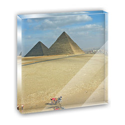 "Made on Terra - The Great Pyramids of Egypt Mini Desk Plaque and Paperweight - You glance over at your miniature acrylic plaque and your spirits are instantly lifted. It's just too cute! From it's petite size to the unique design, it's the perfect punctuation for your shelf or desk, depending on where you want to place it at that moment. At this moment, it's standing up on its own, but you know it also looks great flat on a desk as a paper weight. Choose from Made on Terra's many wonderful acrylic decorations. Measures approximately 4"" width x 4"" in length x 1/2"" in depth. Made of acrylic. Artwork is printed on the back for a cool effect. Self-standing."