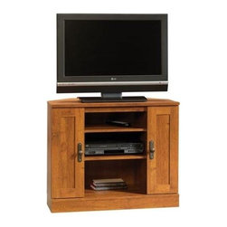 Sauder - Harvest Mill Corner Entertainment Stand in Ab - Storage area behind the corner entertainment stand. Holds up to a 35.5 in. TV (Maximum 95 lbs). Doors have adjustable shelf. Holds 28 cardboard case VHS tapes, 24 oversized VHS tapes, 68 CDs or 52 DVDs. 2 Adjustable shelves hold audio and video equipment. Made of engineered wood. Assembly required. Middle shelves: 17.5 in. W. 36 in. W x 19 in. D x 29 in. H