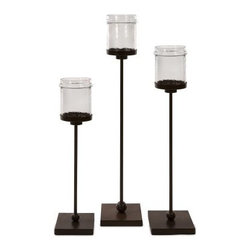 Flamenco Floor Candle Holders - Set of 3 - Clear glass jar-style holders atop slender iron bases define the Flamenco Floor Candle Holders - Set of 3. Elegant simplicity has never been easier. Candles not included.About IMAXWhat began as a small company importing copper flower containers in 1984 by Al and Faye Bulak has developed into one of the top U.S. import companies serving the At Home market today. IMAX now provides home and garden accessories imported from twelve countries around the world, housed in a 500,000 square foot distribution center. Additional sourcing, product development and showroom facilities in the USA, India and China make IMAX a true global source. They're dedicated to providing products designed to meet your needs. This is achieved through a design and product development team that pushes creativity, taste and fashion trends - layering styles, periods, textures, and regions of the world - to create a visually delightful and meaningful environment. At IMAX, they believe style, integrity, and great design can make living easier.