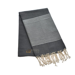 Fouta Beach Towel - Whether relaxing at the beach or lounging by the pool, you'll look stylish with this luxurious fouta. The 100 percent natural cotton towel is soft, absorbent and available in a variety of colors. It's even sophisticated enough to use as a wrap.