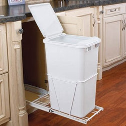 Rev-A-Shelf Single Pull Out Full Extension Slides 50 qt. Trash Can - The Rev-A-Shelf Single Pull-Out Full Extension Slides 50-Quart Trash Can will keep all waste hidden under any cabinet space keeping your kitchen nice and tidy. The plastic trash can features a heavy-duty wire frame construction full-extension ball bearing slides and easy bottom-mount installation with just four screws. The durable pull-out waste container is available in a white polymer finish. It arrives fully assembled and carries the standard Rev-A-Shelf lifetime guarantee. Dimensions: 22L x 12.25W x 24.25H inches.Minimum cabinet opening Width: 12.375 inches Depth: 22.125 inches Height: 24.375 inches About Rev-A-ShelfOriginally a division of Ajax Hardware Rev-A-Shelf was established in 1978 as a family-owned manufacturer of a variety of helpful home products. Rev-A-Shelf offers Lazy Susans kitchen drawer organizers cabinet and pantry pull-outs and functional waste containers. All products consist of polymer wire wood and stainless steel components which will seamlessly complement kitchen appliances and accessories. Rev-A-Shelf aims to revolutionize the way kitchens are organized across the country.