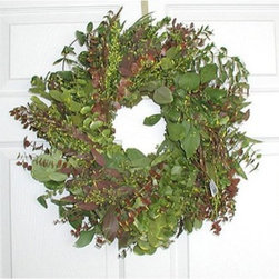 17 in. Blush Eucalyptus Wreath - The 17-inch Blush Eucalyptus Wreath is an appealing mixture of earthy greens and shades of rich plum and burgundy. It is made with many varieties of pleasantly aromatic eucalyptus including Baby Teardrop Seeded Spiral and Silver Dollar Eucalyptus. It is 17 inches in diameter and makes a beautiful addition to your entryway door. Welcome guests to your home in style!This product is designed for indoor use or outdoor use in a protected area. Direct exposure to sunlight and humidity over long periods of time will result in nominal fading. Also be careful when placing your wreath garland or swag over a heat source as high temperatures may result in damage. Follow these easy regulations and you'll have a maintenance-free product that adds plenty of seasonal charm.