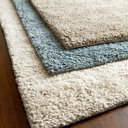 """Exquisite Rugs - Shag Rug 9'6"""" x 13'6"""" - BEIGE - Exquisite RugsShag Rug 9'6"""" x 13'6""""DetailsRug has thick shag pile.Hand knotted of New Zealand wool.Size is approximate.Imported.See our Rug Guide for tips on how to measure for a rug choosing weaves and patterns and more.Please note: Rugs (especially wool rugs) are prone to a natural shedding process. With regular vacuuming the shedding will decrease over time. Hand-knotted rugs tend to shed less than hand-tufted rugs and flatweave rugs will shed less than those with a deeper pile but all rugs will shed more in high-traffic areas than they do in lower-traffic spaces. Unfortunately we cannot provide rug swatches at this time. We apologize for the inconvenience.We recommend using a rug pad with every indoor rug to prolong its beauty by minimizing everyday wear and tear and providing a little breathing space to help prevent fiber damage. A pad also helps stabilize the rug reducing slippage on hard floors."""
