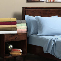 None - Egyptian Cotton 300 Thread Count Split King-size Solid Sheet Set - Cover yourself in the folds of luxury with this romantic king-size sheet set. Made of 300-count Egyptian cotton,this set comes with one flat sheet,two fitted sheets,and two king pillowcases. This is everything that you need to sleep in comfort.