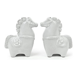 Jonathan Adler Horse Salt & Pepper Shakers - Jonathan Adler's interpretation of the horse is inspired by icons of the 1960s and 1970s. I love these little salt and pepper shakers and would use them anywhere in the house.
