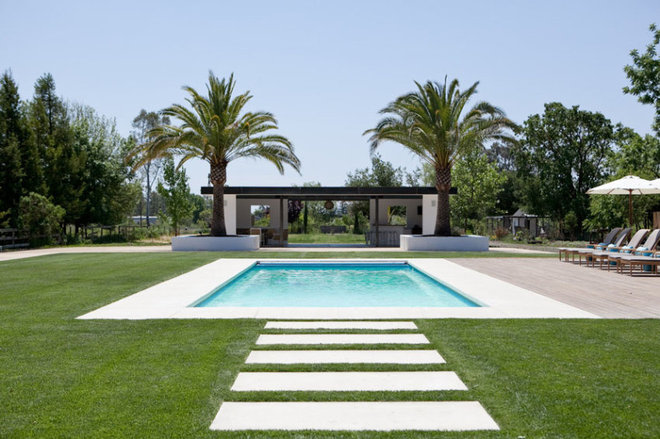Farmhouse Pool by Rollin Landscape Design