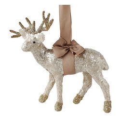 Frontgate - Mica Deer Ornament - Beautifully hand-crafted. Shiny mica finish with silver glitter detailing. Hangs from decorative ribbon. This grand buck will stand out amongst all the ornaments in your tree - seemingly shimmering like the season itself. Covered in shiny mica, with antlers and hooves adorned with silver glitter, he hangs gracefully from a beautiful hand-tied ribbon. Handmade precision makes this winter creature seem frozen in time.  .  .  . Made in USA.