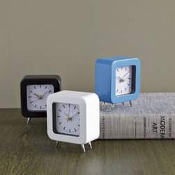 Colored Metal Footed Clock - These little retro clocks are perfect for popping on a laundry room shelf to let you know how long you've been sudsing your duds.