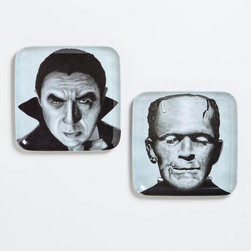 Frankenstein and Dracula Appetizer Plates - These appetizer plates with classic supernatural villains add a kitschy touch to your soiree.