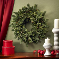 30 in. Pine & Pinecone Wreath - Combining the rich greens and browns of the winter season the 30 in. Pine & Pinecone Wreath welcomes friends and family through the front door over the hearth or on any interior wall. Nothing quite reflects the holidays like a seasonal wreath.About Nearly Natural Inc.For over 75 years Nearly Natural Inc. has been providing conscientious consumers with beautiful alternatives to natural decorations. Employing and advised by naturalists who understand the live plant world Nearly Natural is able to recreate the most realistic-looking decorative items for homes offices and businesses. Driven by a true commitment to customer service attention to detail and natural philosophy Nearly Natural strives to bring customers the most beautiful unique and striking faux fauna and flora on the market.