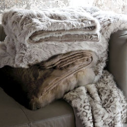 Faux Fur Throw - There is no doubt that it gets cold in Northern Europe! Fur blankets are always on display in Scandinavian homes, and these faux-fur blankets from West Elm are perfect for keeping warm on cold winter nights.
