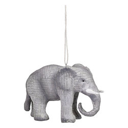 Paper Mache Elephant Holiday Ornament - This papier-mache elephant is made of newsprint, which is a big look in ornaments this year.