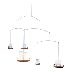 Flensted Mobiles - Viking Mobile - 5 Ships - Travel back in time with these iconic Viking ships. With carved teak hulls and sails at full mast, they add an undeniable sense of adventure to your space. Even the faintest breeze will set the fleet in motion.