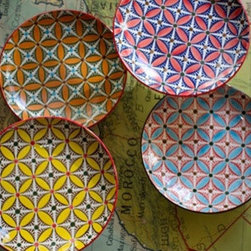 Ceramic Hand-Painted Plates - I adore these striking hand-painted plates! The patterns and colors are so vibrant and fun.