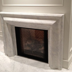 White Marble Fireplace Surrounds - Custom designed white marble fireplace surround. Added as a surround to complement a gas firplace insert.